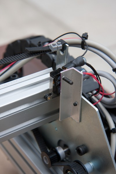 By default, the machine has no limit or homing switches. After running it into the edge a couple times, we quickly realize this was not acceptable. The limit switches are microswitches mounted on an aluminum angle making them adjustable.