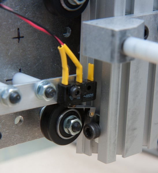 The Z-axis limit switch was more tricky, because there's nothing convenient to mount it on. Luckily, the spare nylon spacers from the Shapeoko kit had exactly the right length to trigger off a bolt screwed into the makerslide.