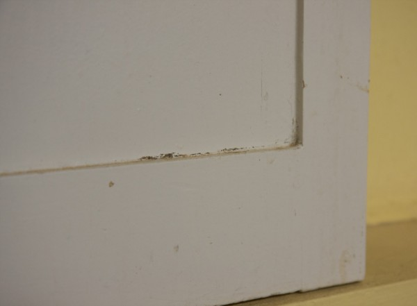 A closeup of the questionable condition of the paint on the cabinets.