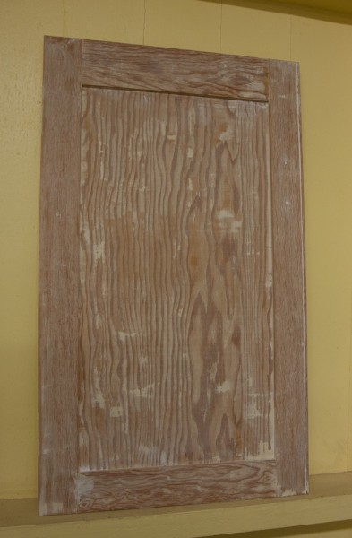 Here's a cabinet after stripping. I'm not sure what the wood is, but it has quite a noticeable grain pattern.